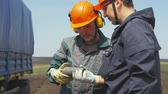 shale : KAZAN, TATARSTAN  RUSSIA - APRIL 17 2018: Closeup of a worker examines prospecting in a pit and colleague. Stock Footage