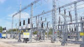 transformatör : isolators installed at transmission substation distributing energy