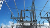 elektrownia : motion between transformer supports against sky Wideo