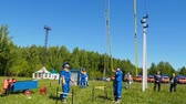 пожарный : people connect equipment with electric wires on training field