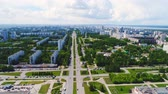 cross the road : city crossed by wide avenue against cloudy sky Stock Footage