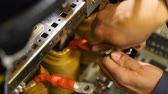 amper : employee puts fastener into hole and fixes wire with tool Stok Video