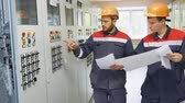 transformador : electricians come up to network power cabinet and press button