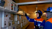 ток : technicians control operating transmission equipment