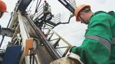well site : worker controls with levers pipe installation on exploratory drilling machine