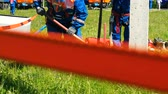 závodník : employees fix pole for transmission lines on field at competitions Dostupné videozáznamy