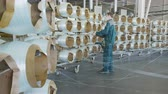 produção : employees in masks monitor fiberglass bobbins unwinding to produce materials Stock Footage