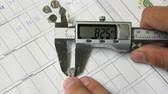 technikus : closeup technician measures small parts with digital meter
