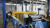 capa dura : automated machine tool stretches thin metal grid stipe