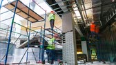 vesta : workers team makes finishing operations on scaffolding timelapse
