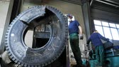 likvidace : motion to huge lorry tire cut by special modern machine