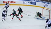 палка : slow motion shot on goal and goalkeeper catching puck