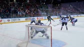 goleiro : slow motion hockey player shots puck past opponent gate