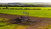 economia rural : timelapse installation of pump jack throughout months