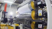 refrigeracion : motion to machine tool with rollers stretching plastic sheet Archivo de Video