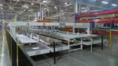 refrigeracion : production line manipulator takes metal and puts on conveyor