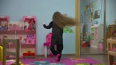 pingouin : Little Active Girl Dancing in the room Vidéos Libres De Droits