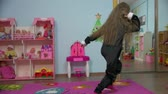pingouin : Little Active Girl Is Dancing in the room