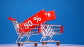 big sale concept with moving shoping carts Stock Footage