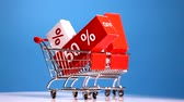 discounts and sales, shopping carts on blue background Stock Footage