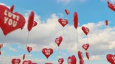 Beautiful 3D animation. Red balloons with shape of valentines heart flies high to the blue sky. This video can be used like greeting card for wedding, valentines day or any celebration.