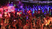 lifestyle : PHANGAN, THAILAND - APRIL 15, 2014 :Unidentified people participate in the Full Moon party on island Koh Phangan. The event now attracts anywhere from 40,000 party-goers on a normal month