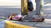 CEBU, PHILIPPINES - MARCH 15, 2014 : Poverty in Philippines, a unidentified boy sleeping on the street. Nearly one of every three Filipino children aged 4 to 10 is underweight Wideo