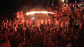 ada : PHANGAN, THAILAND - APRIL 15, 2014 :Unidentified people participate in the Full Moon party on island Koh Phangan. The event now attracts anywhere from 40,000 party-goers on a normal month