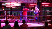 box : PATTAYA, THAILAND - NOVEMBER 15, 2014: Unidentified players in Muaythai  Muay Thai Kai Chon in Walking Street.  Walking Street is red-light district with many restaurants, go-go bars and brothels