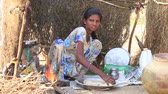 chapati : PUSHKAR, INDIA - OCTOBER 28, 2014: Unidentified Indian girl prepares chapati outdoor in Thar desert where the annual Pushkar Camel Mela. This fair is the largest camel trading fair in the world.
