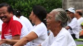 teeth : UBUD, INDONESIA - FEBRUARY 27, 2015 : Unknown Balinese people come to training on laughter therapy and yoga classes and dance Stock Footage