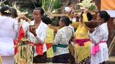 indonesia : UBUD, BALI, INDONESIA - MARCH 20, 2015 : Unidentified Indonesian people celebrate Balinese New Year and the arrival of spring. People praying at holy temple during the religious ceremony Stock Footage