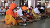 chapati : AMRITSAR INDIA SEPTEMBER 27 2014: Unidentified poor indian people eating free food at a soup kitchen in the Sikh Golden Temple