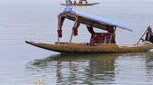 small : SRINAGAR, INDIA - JUNE 06, 2015: Lifestyle in Dal lake, local people use Shikara, a small boat for transportation in the lake of Srinagar, Jammu and Kashmir state, India Stock Footage