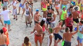 ada : PHANGAN, THAILAND - JANUARY 5, 2015: Unidentified people participate in the Full Moon party on island Koh Phangan. The event now attracts anywhere from 40,000 party-goers on a normal month