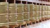 escrita : Buddhist prayer wheels in Tibetan monastery with written mantra. India, Mcleod Ganj, Dharamsala