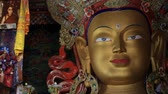 monastic : Ladakh, INDIA - CIRCA 2015 Close up colorful sculpture of Maitreya buddha at Thiksey Monastery, Tibetan Buddhist monastery in Ladakh, India Stock Footage