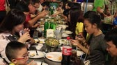 przetwory : BANGKOK, THAILAND - JANUARY 06, 2016: People eating street food in Chinatown. Yaowarat Road China Town is famous for its night life for dining and eating with lively environment.