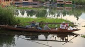 small : SRINAGAR, INDIA - JUNE 09, 2015: Lifestyle in Dal lake, local people use Shikara, a small boat for transportation in the lake of Srinagar, Jammu and Kashmir state, India