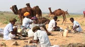 chapati : PUSHKAR, INDIA - OCTOBER 28 2014: Unidentified Indian men prepare a meal on a campfire during Pushkar Camel Mela. This fair is the largest camel trading fair in the world.