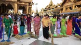 shwedagon : YANGON, MYANMAR - JANUARY 9, 2016: Unidentified group of pilgrims participate in a ceremony with brooms at the Shwedagon Pagoda. Shwedagon Pagoda is the most sacred Buddhist pagoda for the Burmese
