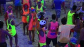 ada : KOH PHANGAN, THAILAND - DECEMBER 7 2014: Unidentified people participate in the Full Moon party on island Koh Phangan. The event now attracts anywhere from 40,000 party-goers on a normal month