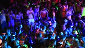 ada : KOH PHANGAN, THAILAND - APRIL 15, 2014: Unidentified people participate in the Full Moon party on island Koh Phangan. The event now attracts anywhere from 40,000 party-goers on a normal month