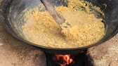 rice pan : Cooking on a fire in the open air. So feed merchants at the fair. Bagan. Myanmar Stock Footage