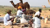 chapati : PUSHKAR, INDIA - OCTOBER 28 2014: Unidentified Indian men cook food over a campfire during the Pushkar Camel Mela. This fair is the largest camel trading fair in the world