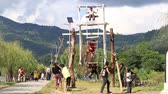 valente : POKHARA, NEPAL - OCTOBER 04, 2016: Brave children rides on a very big wooden swing