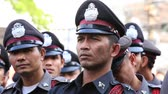 peaked : BANGKOK, THAILAND - FEBRUARY 08, 2016: Unknown Thai policeman to keep order in the street Yaowarat during the celebration of Chinese New Year in Chinatown