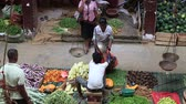 november : MATARA, SRI LANKA - NOVEMBER 5, 2014: Unidentified sellers in street market sell fresh fruits and vegetables. Many people buy fresh food on the street rather than at shops.