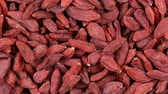 crop loss : Dried Goji Berries. Loop rotation. Front of the camera rotates plate with bright berries Goji. Close up Stock Footage