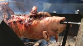 broiling : Roasting piglet, grilled pig at street food market in Koh Phangan, Thailand. Close up Stock Footage